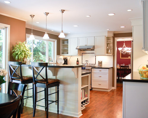 Traditional kitchen idea in Seattle with shaker cabinets, white cabinets  and white backsplash