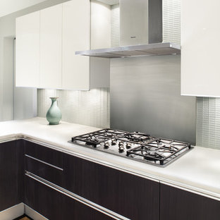 Example Of A Minimalist Kitchen Design In New York With Flat Panel  Cabinets, Dark