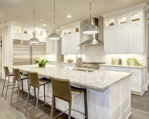 Large transitional l-shaped light wood floor eat-in kitchen idea in New York
