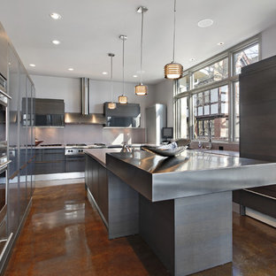 This is an example of a large modern u-shaped separate kitchen in Other with a double-bowl sink, flat-panel cabinets, grey cabinets, zinc benchtops, panelled appliances, concrete floors, with island and brown floor.