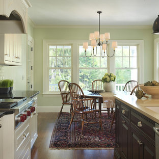 Traditional eat-in kitchen inspiration - Elegant dark wood floor eat-in kitchen photo in Boston with subway tile backsplash, an undermount sink, beaded inset cabinets, white cabinets, white backsplash, stainless steel appliances and quartzite countertops