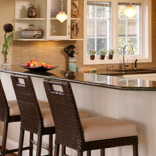 Trendy l-shaped light wood floor eat-in kitchen photo in DC Metro with glass-front cabinets, white cabinets, brown backsplash, a drop-in sink, quartzite countertops, stone tile backsplash, stainless steel appliances and no island