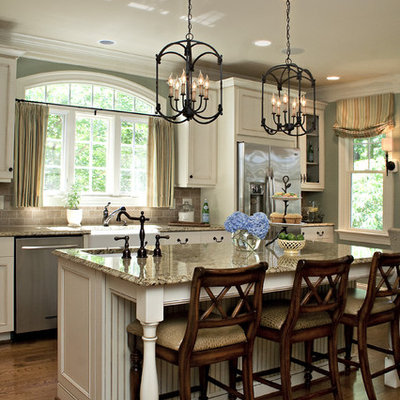 Kitchen - traditional kitchen idea in Raleigh with stainless steel appliances