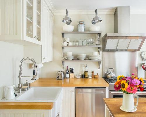 cuisine avec une fa ade en inox et un vier de ferme photos et id es d co de cuisines. Black Bedroom Furniture Sets. Home Design Ideas