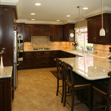 Traditional Kitchen by Reborn Cabinets Inc.