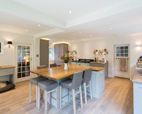 Exceptional Large Farmhouse U Shaped Medium Tone Wood Floor Eat In Kitchen Idea In  London