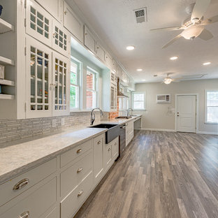Large rustic eat-in kitchen remodeling - Large mountain style galley dark wood floor eat-in kitchen photo in Austin with a farmhouse sink, open cabinets, white cabinets, quartzite countertops, multicolored backsplash, marble backsplash, stainless steel appliances and no island