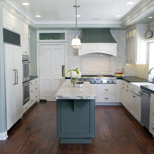 Elegant kitchen photo in Orange County with a farmhouse sink and paneled appliances