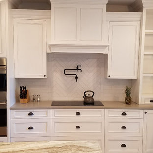 This is an example of a large galley eat-in kitchen in Other with an undermount sink, louvered cabinets, white cabinets, granite benchtops, white splashback, window splashback, stainless steel appliances, medium hardwood floors, with island and grey benchtop.