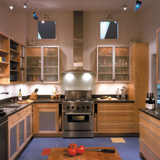 Contemporary enclosed kitchen designs - Example of a trendy u-shaped blue floor enclosed kitchen design in DC Metro with glass-front cabinets and light wood cabinets