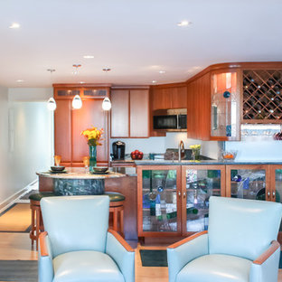Traditional eat-in kitchen inspiration - Eat-in kitchen - traditional u-shaped eat-in kitchen idea in Boston with an undermount sink, flat-panel cabinets, medium tone wood cabinets, granite countertops, blue backsplash and paneled appliances