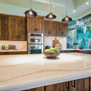 Large transitional open concept kitchen ideas - Large transitional u-shaped open concept kitchen photo in Phoenix with a farmhouse sink, shaker cabinets, dark wood cabinets, quartz countertops, white backsplash, quartz backsplash, stainless steel appliances, an island and white countertops