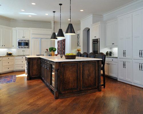 Mediterranean kitchen idea in Houston with limestone countertops
