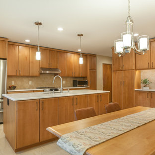 Design ideas for a mid-sized contemporary l-shaped eat-in kitchen in Detroit with flat-panel cabinets, medium wood cabinets, beige splashback, porcelain splashback, stainless steel appliances, with island, beige floor, multi-coloured benchtop and an undermount sink.
