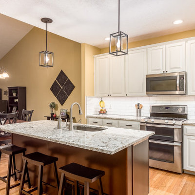 Mid-sized transitional l-shaped eat-in kitchen photo in Columbus with granite countertops and an island