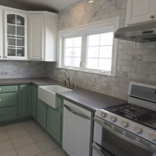 Design ideas for a mid-sized beach style l-shaped separate kitchen in Los Angeles with a farmhouse sink, beaded inset cabinets, green cabinets, quartz benchtops, white splashback, stone tile splashback, white appliances, ceramic floors and no island.