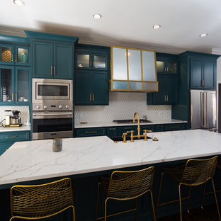 Large transitional open concept kitchen inspiration - Open concept kitchen - large transitional galley dark wood floor open concept kitchen idea in Birmingham with a farmhouse sink, shaker cabinets, gray cabinets, white backsplash, stainless steel appliances, an island and white countertops
