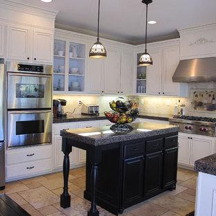 Traditional kitchen in San Diego with white cabinets, beige splashback, stainless steel appliances and beige floor.