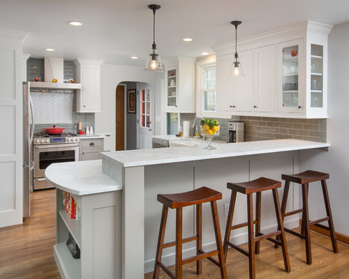 Inspiration For A Transitional Medium Tone Wood Floor Kitchen Remodel In Columbus With Shaker Cabinets