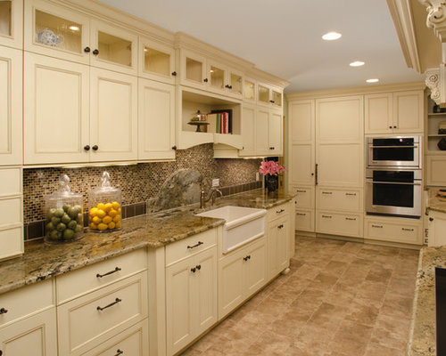 Mid Sized Traditional Galley Ceramic Floor Enclosed Kitchen Idea In Chicago  With A Farmhouse Sink