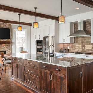Traditional kitchen photos - Elegant dark wood floor and brown floor kitchen photo in Atlanta with shaker cabinets, white cabinets, brown backsplash, subway tile backsplash, stainless steel appliances and an island