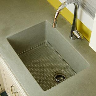 シアトルのエクレクティックスタイルのおしゃれなキッチン (一体型シンク、フラットパネル扉のキャビネット、白いキャビネット、コンクリートカウンター、セメントタイルのキッチンパネル、シルバーの調理設備の) の写真