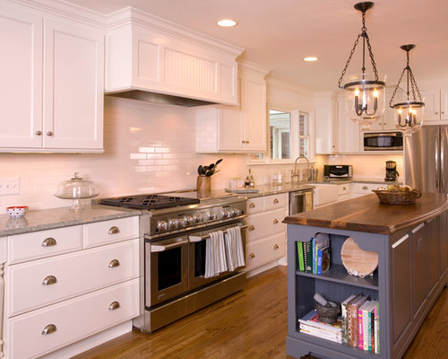 Example Of A Classic L Shaped Kitchen Design In Charlotte With Stainless  Steel Appliances,