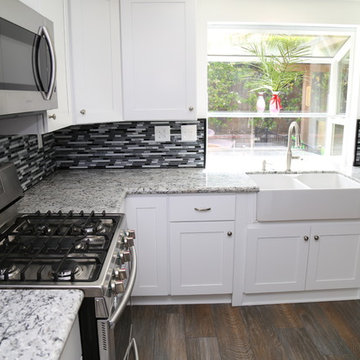 Kitchen Remodel with White Shaker Style Cabinets and Granite