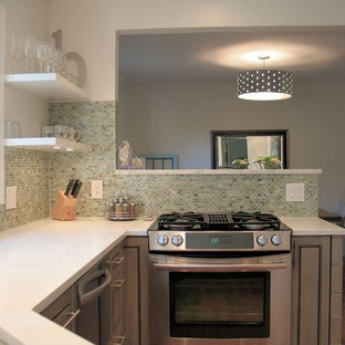 Example of a trendy eat-in kitchen design in Indianapolis with stainless steel appliances, green backsplash, mosaic tile backsplash and gray cabinets