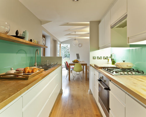 1950s Galley Enclosed Kitchen Photo In Other With Stainless Steel  Appliances, Wood Countertops, A