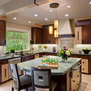 サンフランシスコの中サイズのアジアンスタイルのおしゃれなキッチン (エプロンフロントシンク、シェーカースタイル扉のキャビネット、大理石カウンター、ベージュキッチンパネル、ガラスタイルのキッチンパネル、シルバーの調理設備の、セラミックタイルの床、ベージュの床、中間色木目調キャビネット) の写真