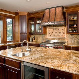 Large southwestern enclosed kitchen photos - Inspiration for a large southwestern medium tone wood floor enclosed kitchen remodel in Phoenix with flat-panel cabinets, black cabinets, marble countertops, multicolored backsplash, ceramic backsplash, stainless steel appliances and an island