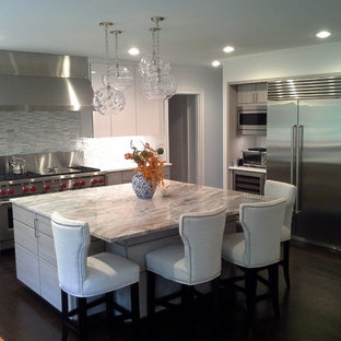 Design ideas for a large modern l-shaped eat-in kitchen in Bridgeport with flat-panel cabinets, white cabinets, grey splashback, stainless steel appliances, with island, marble benchtops, glass tile splashback, dark hardwood floors and brown floor.