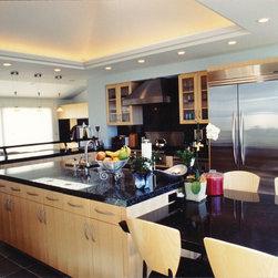 Modern design, maple cabinets, granite countertops, coffered ceiling
