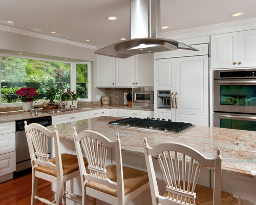 Example Of A Classic L Shaped Kitchen Design In San Francisco With  Raised Panel