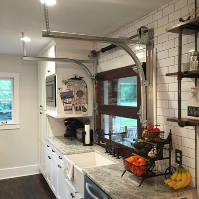 Inspiration for a mid-sized farmhouse galley dark wood floor eat-in kitchen remodel in Atlanta with a farmhouse sink, shaker cabinets, white cabinets, granite countertops, white backsplash, subway tile backsplash, stainless steel appliances and no island