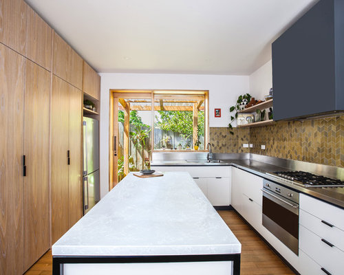 Photo Of A Mid Sized Contemporary U Shaped Open Plan Kitchen In Melbourne  With
