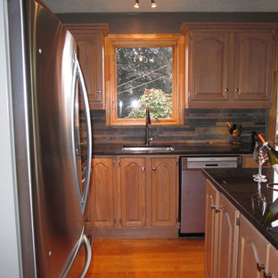 Small country l-shaped eat-in kitchen in Montreal with an undermount sink, louvered cabinets, light wood cabinets, granite benchtops, multi-coloured splashback, porcelain splashback, stainless steel appliances, light hardwood floors and with island.