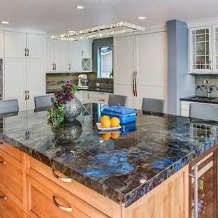 Large transitional light wood floor kitchen photo in San Francisco with an undermount sink, shaker cabinets, white cabinets, gray backsplash, glass tile backsplash, stainless steel appliances and an island