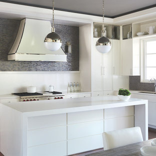 Trendy l-shaped dark wood floor eat-in kitchen photo in Toronto with an undermount sink, flat-panel cabinets, white cabinets, gray backsplash, mosaic tile backsplash, stainless steel appliances and an island
