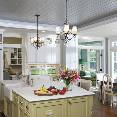 Eat-in kitchen - large traditional l-shaped dark wood floor eat-in kitchen idea in Minneapolis with a farmhouse sink, shaker cabinets, white cabinets, marble countertops, white backsplash, subway tile backsplash, stainless steel appliances and an island
