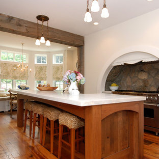 Eat-in kitchen - large rustic l-shaped medium tone wood floor eat-in kitchen idea in New York with stainless steel appliances, recessed-panel cabinets, white cabinets, a drop-in sink, gray backsplash and an island