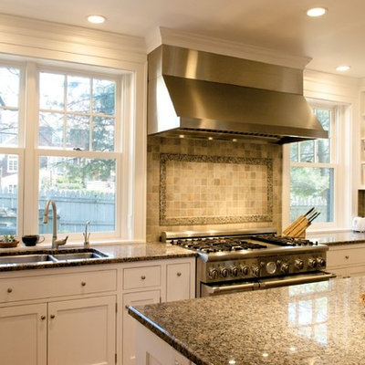 Elegant kitchen photo in Cincinnati with shaker cabinets, stainless steel appliances and granite countertops