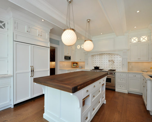 Elegant Kitchen Photo In New York With Wood Countertops And Stainless Steel  Appliances