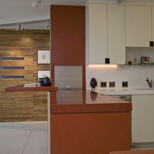 Large contemporary eat-in kitchen designs - Example of a large trendy u-shaped cement tile floor and white floor eat-in kitchen design in Chicago with an undermount sink, flat-panel cabinets, white cabinets, quartz countertops, white backsplash, quartz backsplash, stainless steel appliances, a peninsula and white countertops