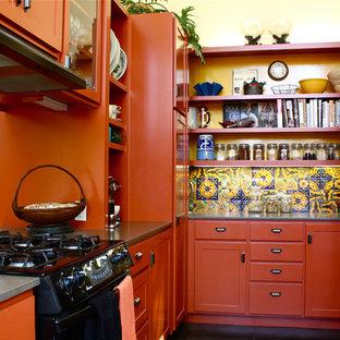 На фото: параллельная, отдельная кухня с открытыми фасадами, оранжевыми фасадами, разноцветным фартуком и техникой под мебельный фасад