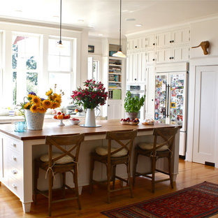 Kitchen - traditional kitchen idea in San Francisco with shaker cabinets, white cabinets and paneled appliances