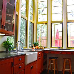 Mediterrane Küche mit Glasfronten, Landhausspüle und orangefarbenen Schränken in Santa Barbara