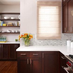 Contemporary kitchen remodeling - Inspiration for a contemporary kitchen remodel in San Francisco with shaker cabinets, dark wood cabinets, quartz countertops, white backsplash and stone tile backsplash