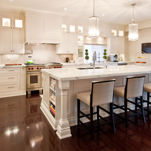 Transitional kitchen appliance - Inspiration for a transitional kitchen remodel in Toronto with recessed-panel cabinets, paneled appliances, marble countertops, white cabinets and gray backsplash